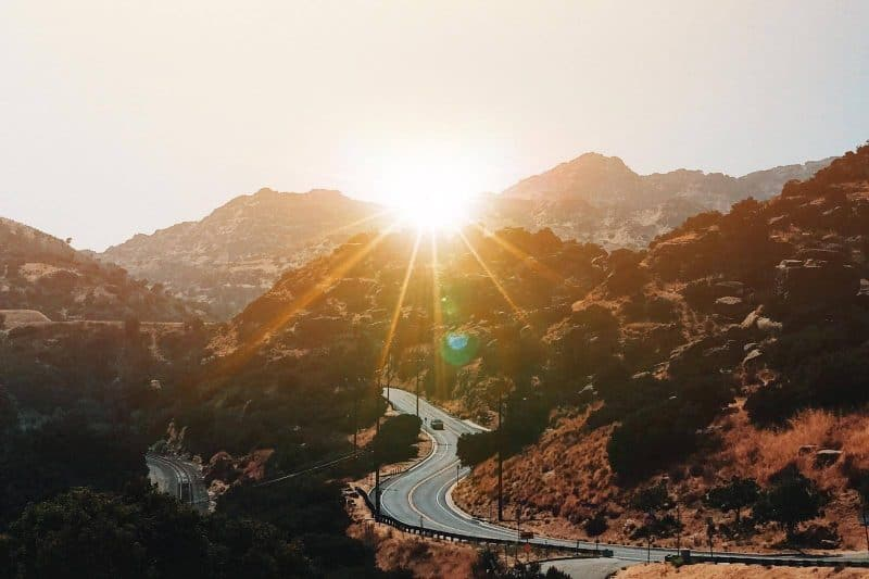 sunset over a mountain road